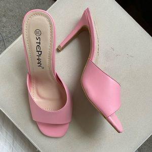Pink heels never worn. Few slight scratches